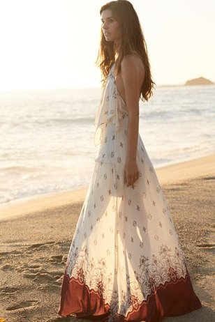 A beautiful girl on the beach at sunset. Styled by Christina Calautti for Topazery Jewelry.