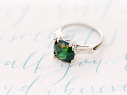 A Topazery vintage engagement ring with chrome tourmaline is one of the stars in a dreamy Hawaiian inspired wedding