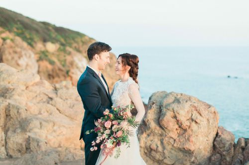 A happy couple after their wedding by the sea