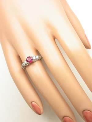 Swirling Ruby and Diamond Engagement Ring