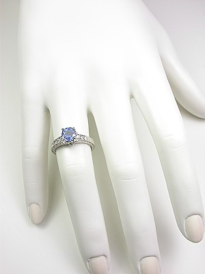Sapphire Engagement Ring with Flower Motif