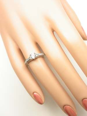 White Sapphire Engagement Ring with Infinity Motif