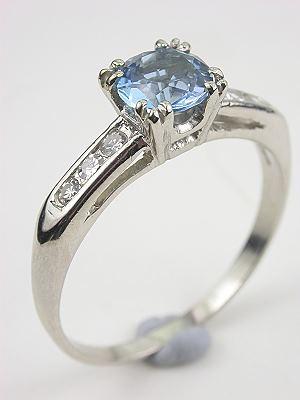 Classic Platinum and Aquamarine Engagement Ring with Airline Design