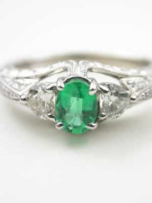 Emerald Engagement Ring with Heart Shaped Diamonds