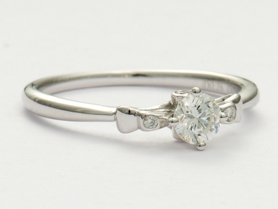 Vintage Style Diamond Engagement Ring with Bows
